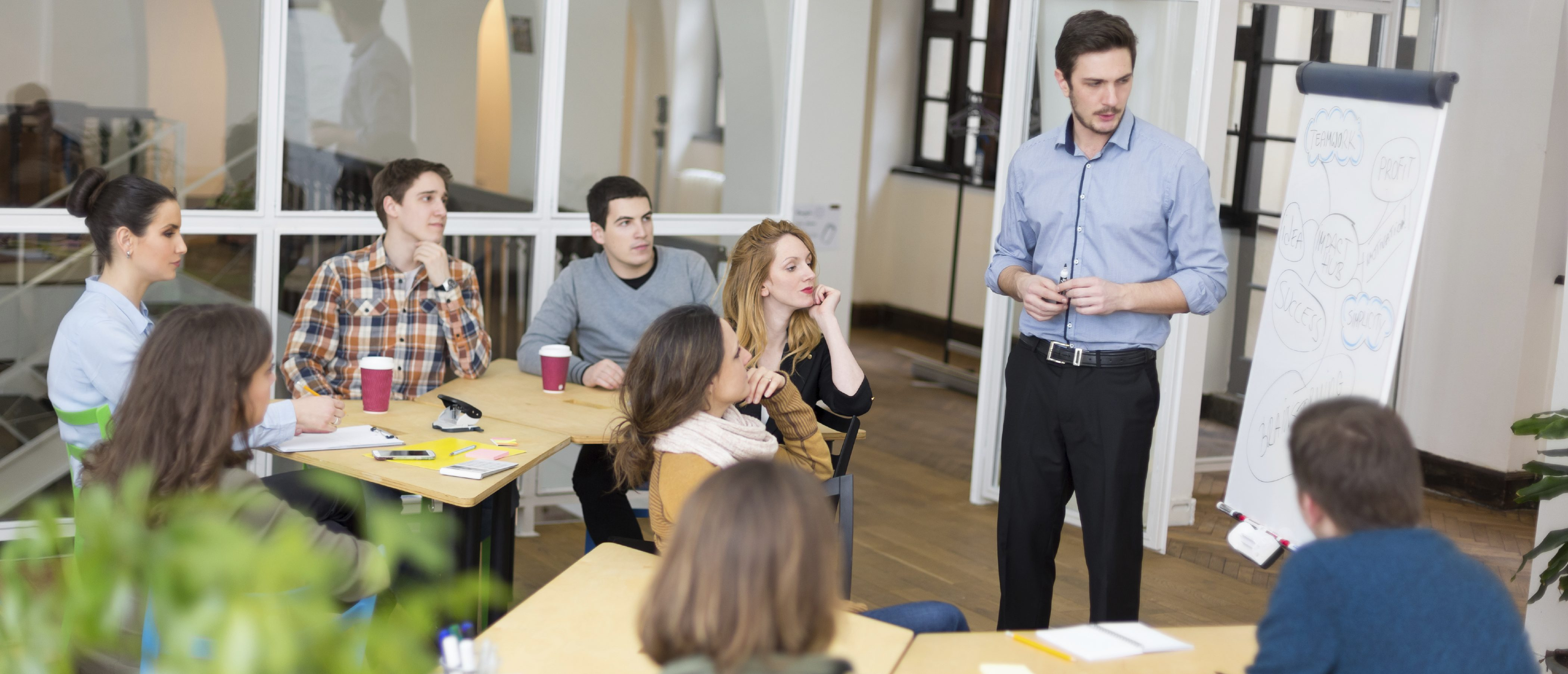 Group of university student sitting in classroom,  listening to lecture